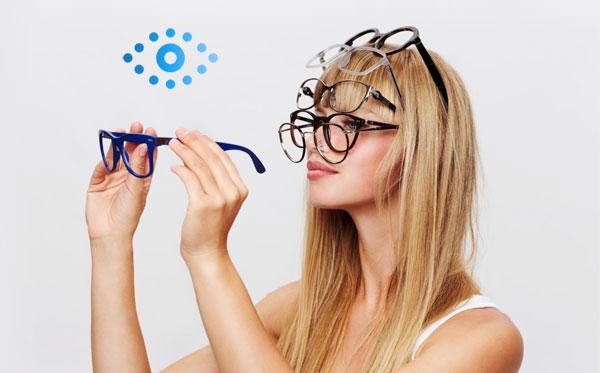 woman holding eyewear